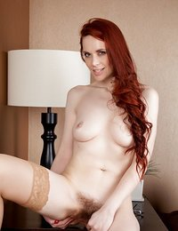 Redhead milf strips off her..